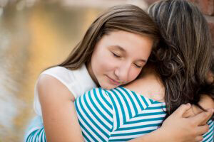 emotional child hugging mother